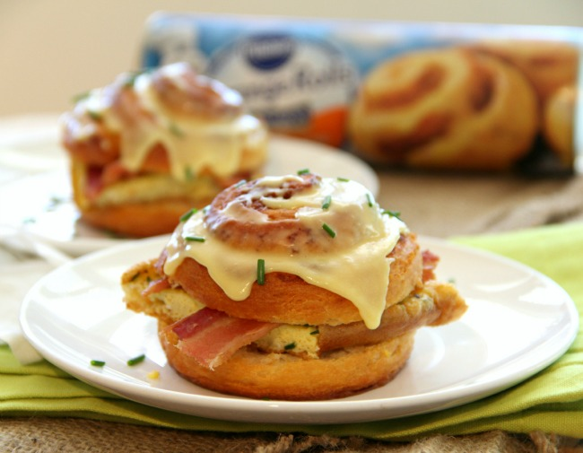 Easy breakfast sandwich stuffed with bacon and chive-flavored eggs, encased in a split sweet orange roll. What a way to start the day!