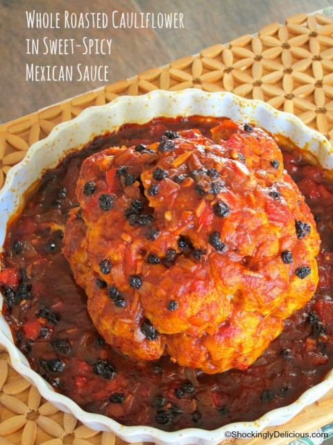 Vegetarian Whole Roasted Cauliflower in Spicy-Sweet Mexican Sauce recipe on ShockinglyDelicious.com