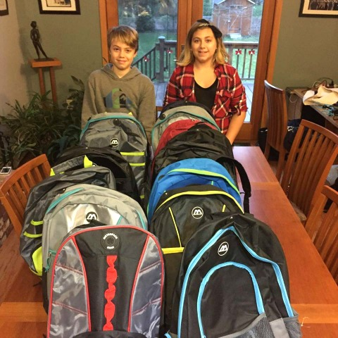 Luke and his cousin Lily make backpacks for homeless