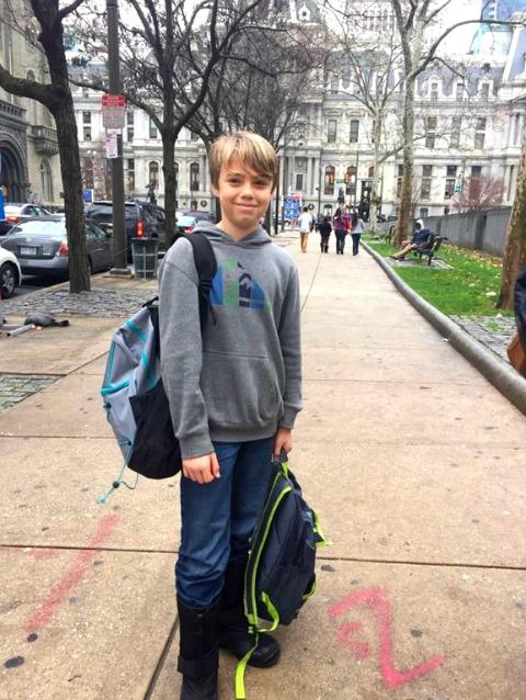 Luke hands out backpacks in Philadelphia