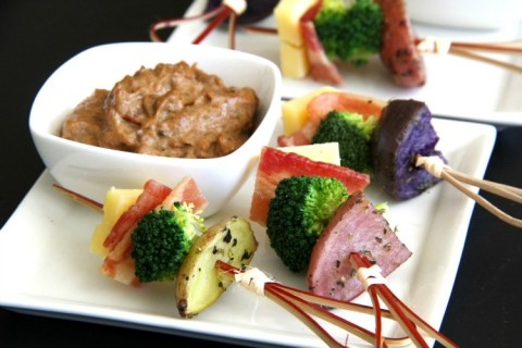 Deconstructed Poutine Bites appetizers have roasted potatoes, bacon, broccoli and cheddar, all on a stick! Give it a dunk into Caramelized Onion Dip | ShockinglyDelicious.com