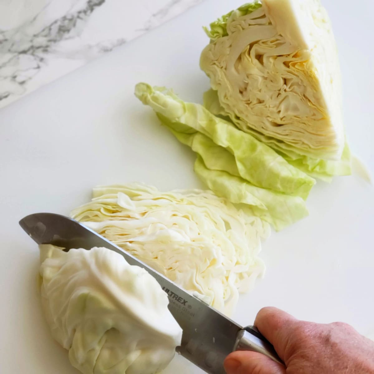 Slice the cabbage finely on ShockinglyDelicious.com