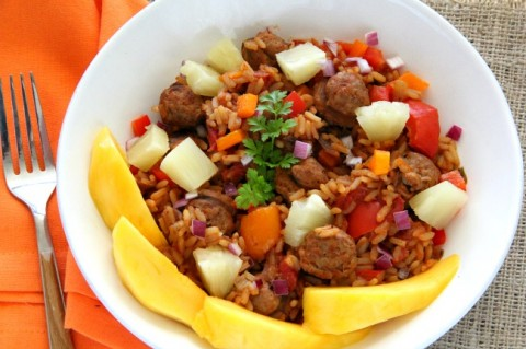 Change up classic Jambalaya with tropical fruit for a Hawaiian Jambalaya to kick off Mardi Gras or any party. Spicy rice, peppers, onions and sausage are topped by pineapple and mango.   ShockinglyDelicious.com
