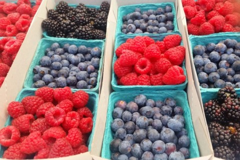 Fresh berries at the farmers market on ShockinglyDelicious.com