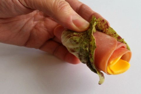 Make a lettuce wrap meat and cheese roll from Smithfield's Ready Snack Go on ShockinglyDelicious.com