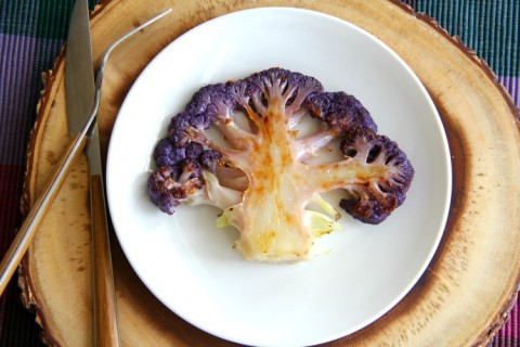 Purple Cauliflower Steaks: Roasting brings out the best caramelized flavors in a simple head of cauliflower dressed with olive oil and salt. You won't want to share. Paleo, vegan, low-carb, low-calorie, diabetic-friendly. It's all the things.| ShockinglyDelicious.com