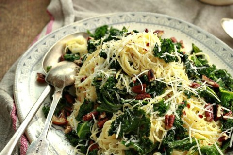 Angel Hair Pasta with Lemon, Kale and Pecans: Slightly bitter kale, bright lemon, crunchy pecans and spicy chili all combine in a pasta dish right at home in Southern California, from Irish chef Stuart O'Keeffe. | ShockinglyDelicious.com