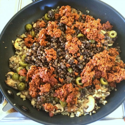 Chorizo, lentil and olives go into the skillet for Picadillo Stuffed Peppers on ShockinglyDelicious.com