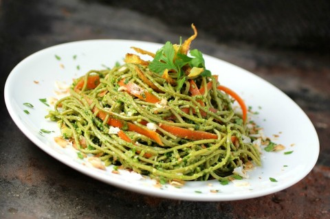 Nutritious spaghetti noodles made from edamame get dressed in a kale-cilantro pesto and topped with big flavors from coconut and ginger, for a vegetarian Edamame Spaghetti with Kale Cilantro Pesto. You can easily make it vegan, as well. | ShockinglyDelicious.com