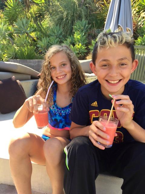 Neighborhood kids drinking Tangerine Raspberry Citrus Coolers
