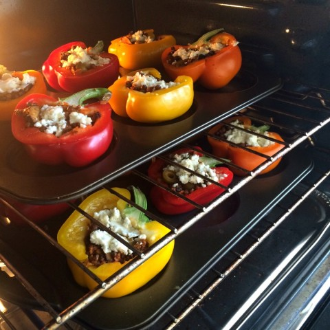Picadillo Stuffed Peppers in the oven on ShockinglyDelicious.com