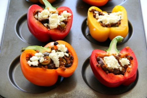 Queso Fresco on top of Picadillo Stuffed Peppers on ShockinglyDelicious.com