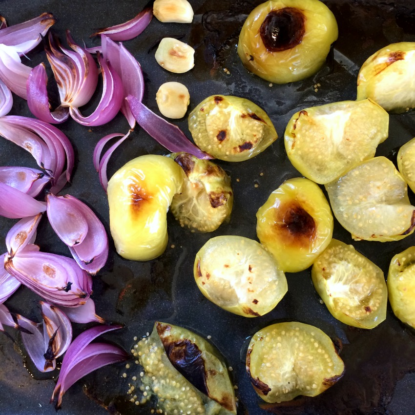 Onions garlic and tomatillos broiled and ready for salsa on ShockinglyDelicious.com