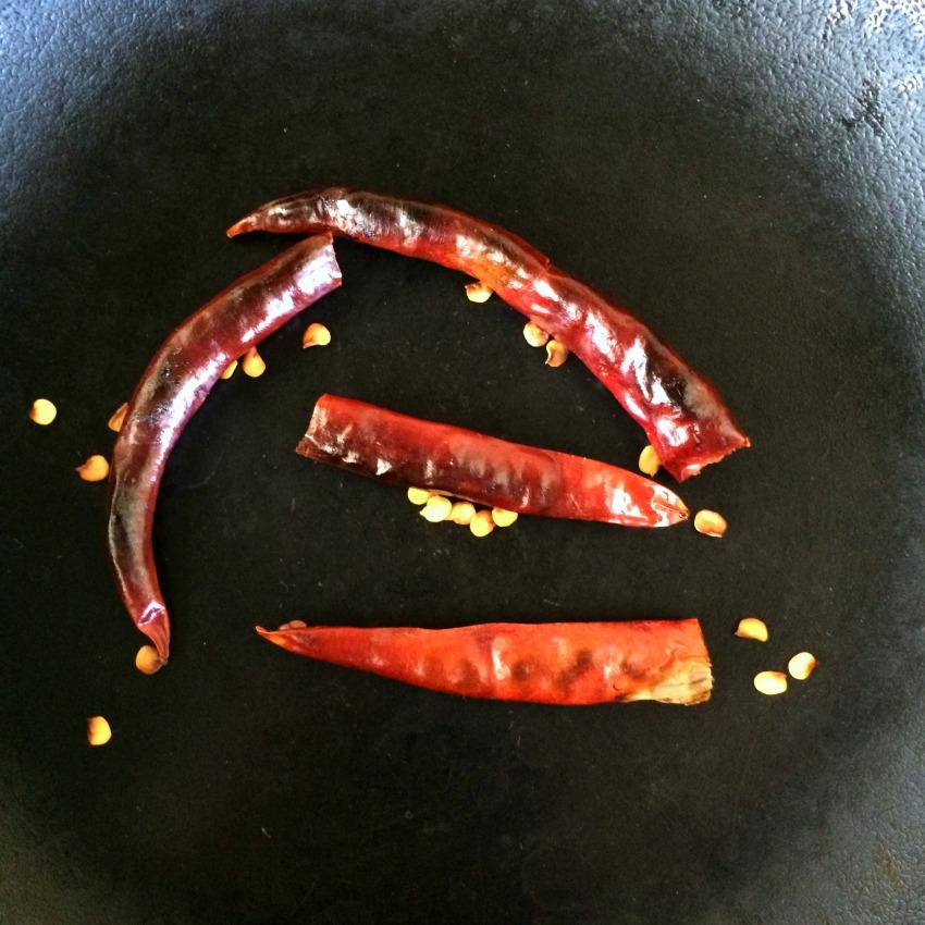 Toasting chiles de arbol for salsa on ShockinglyDelicious.com