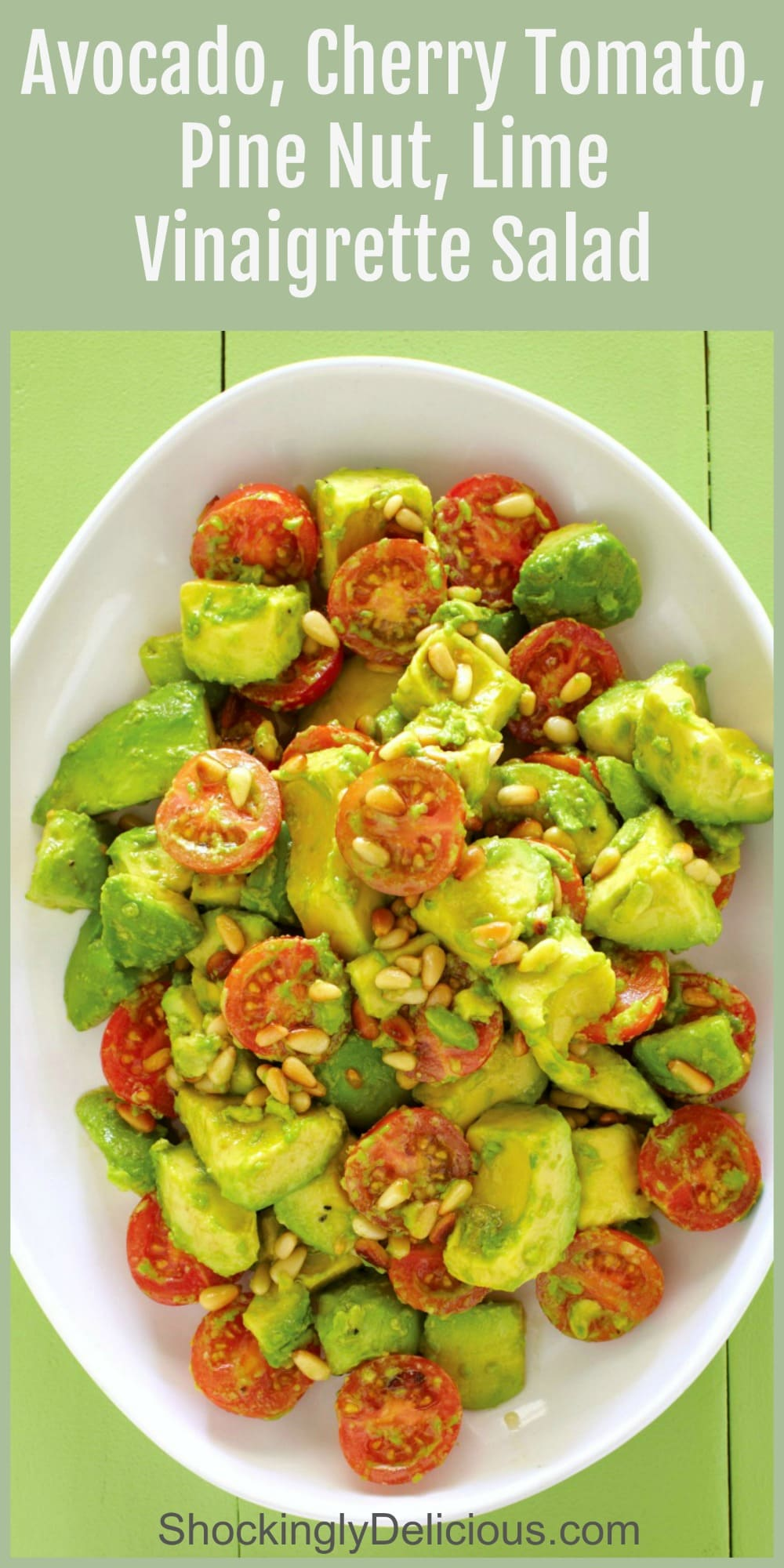 Avocado Cherry Tomato Salad on a large white platter on a greeen background