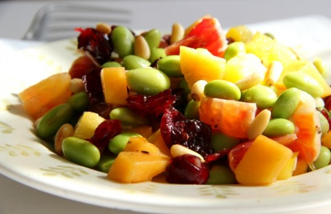 Fruity, vegan Edamame Salad with Persimmon, Peppers and Pine Nuts is a light lunch or side salad full of flavor, crunch and nutrition. Bonus: it's rainbow eye candy, too!