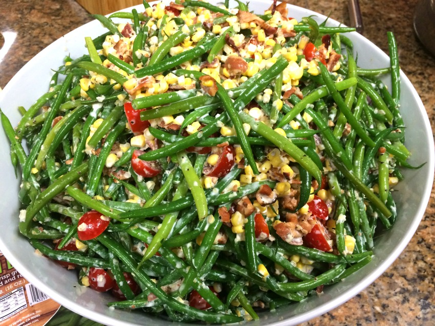 fresh-green-bean-salad-by-rachel-hollis in a white bowl against a stone counter background