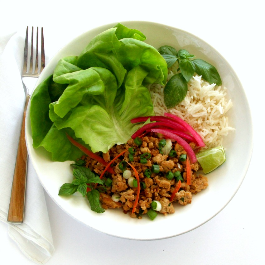 thai-inspired-turkey-lettuce-wraps in a white bowl on a white counter
