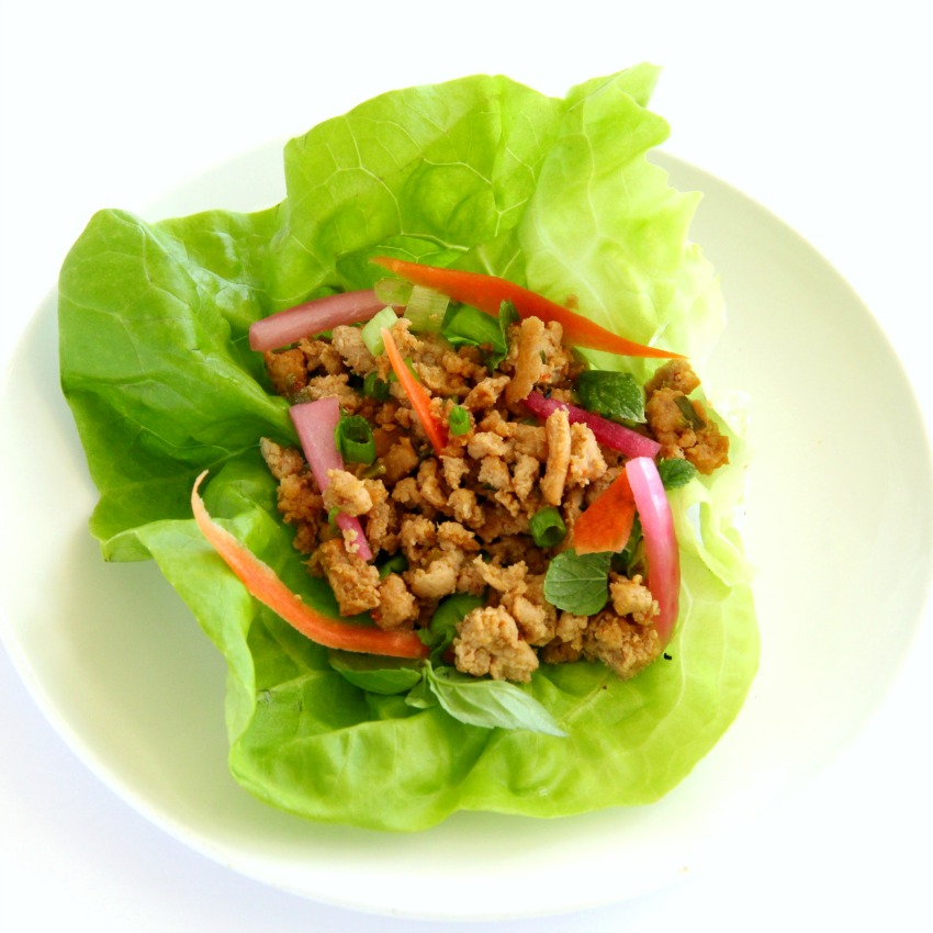 Thai lettuce wrap on a white plate on a white counter