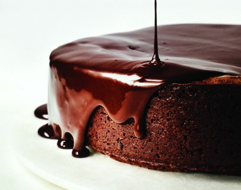 The plummy-berry notes of red wine are highlighted when mixed with chocolate and butter into a glaze that drips over the edges of this decadent Darkest Chocolate Cake with Red Wine Glaze.
