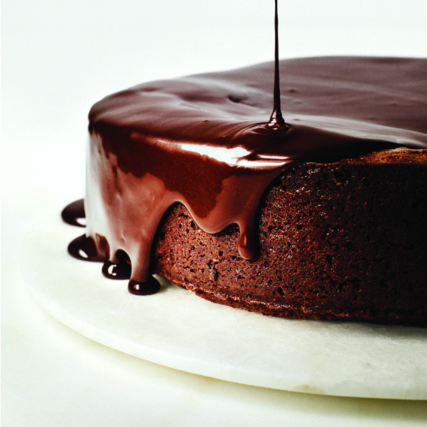 darkest-chocolate-cake-with-red-wine-glaze-dripping on top of it