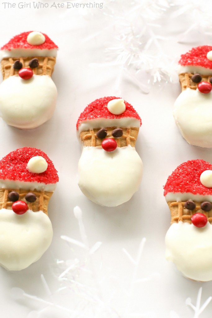 5 santa shaped cookies made from Nutter Butter cookies on a white background