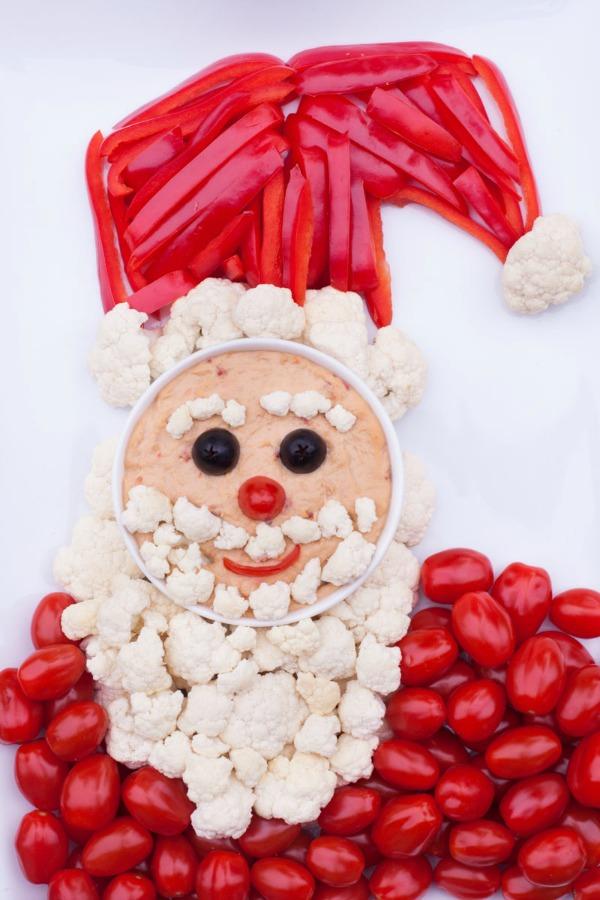 Santa-shaped veggie-tray with cauliflower as beard