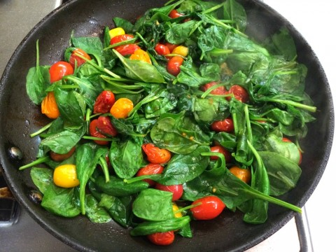 A quick three-ingredient Spinach and Cherry Tomato Saute is always welcome on the plate. Easy, fast and healthy is a great trio of attributes!