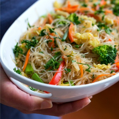 white bowl of vegan pancit held by a person