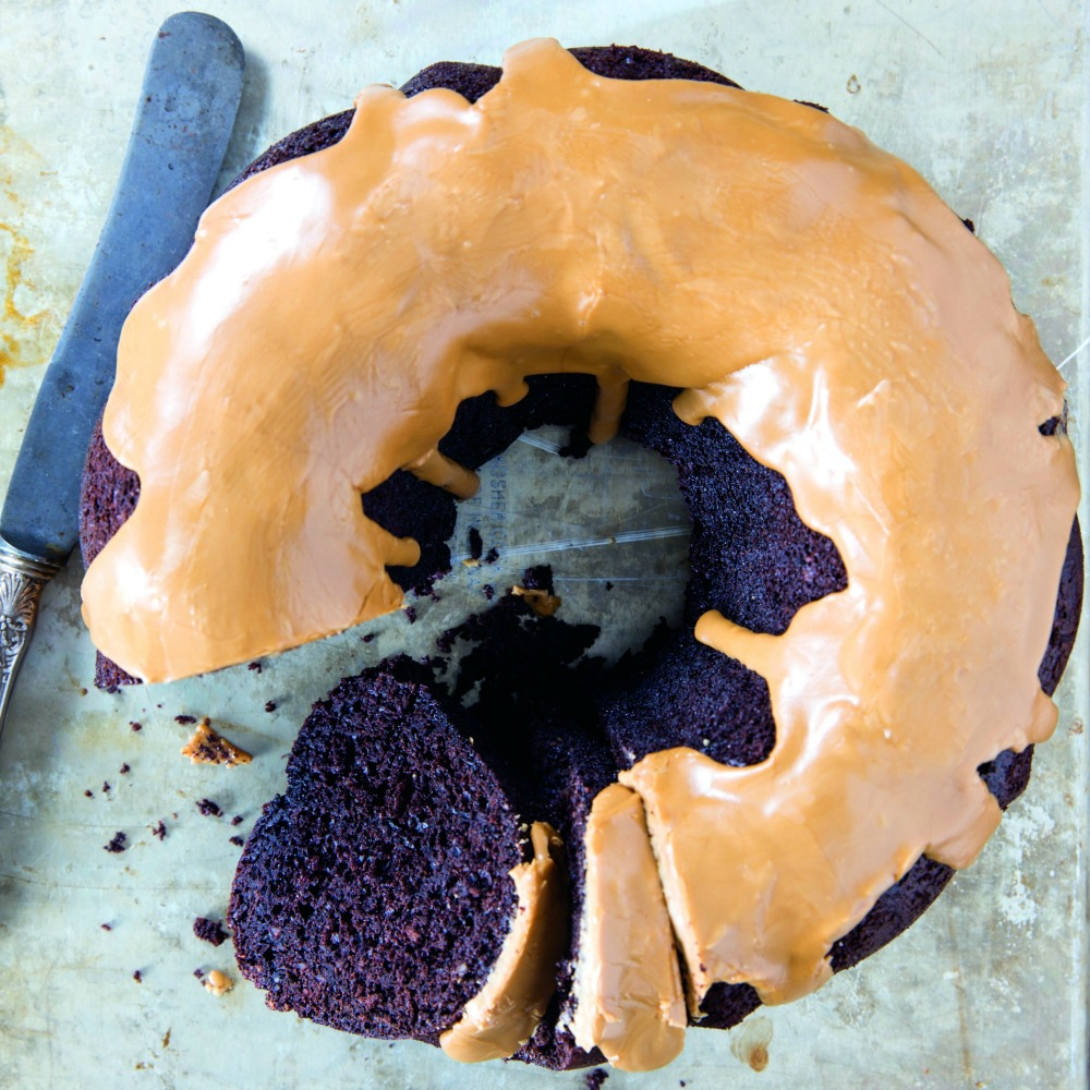Aerial view of Fudgy Chocolate Bundt Cake with Coffee Glaze with a piece cut out