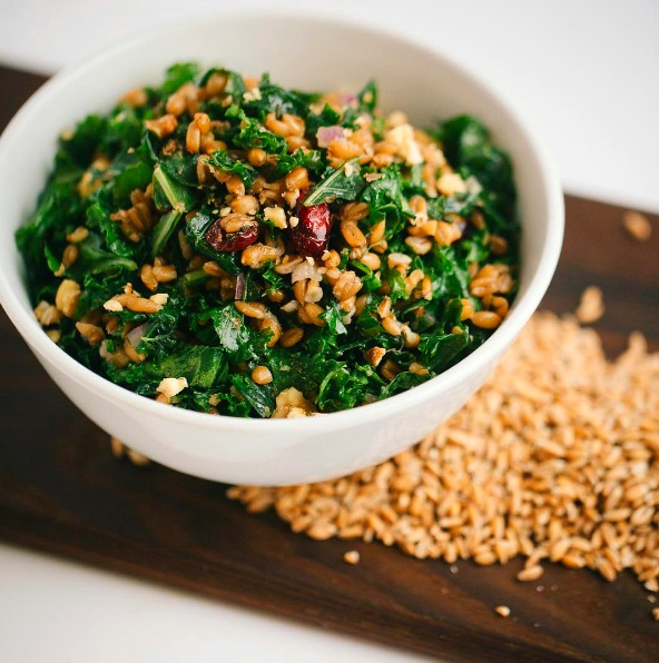 Kale and Spelt Berry Salad with Sweet Cranberries and Lemon Dressing: A masterfully balanced raw vegan kale salad with chewy spelt, sweet cranberries, crunchy walnuts harmonizing with a lemony maple dressing, from Little Eater Restaurant in Columbus, Ohio.