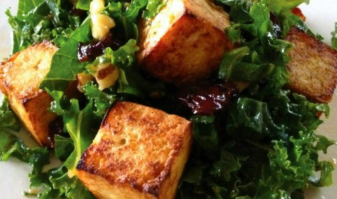 Tofu croutons -- crispy on the outside and soft and tender inside -- are a perfect counterpoint to the verdant kale salad with its sweet cherries and crunchy walnuts. An Asian-inflected dressing completes the dish.