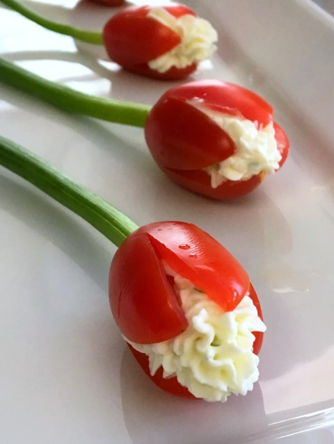 Grape Tomato Cream Cheese Tulips: A bunch of edible Tomato Tulips stuffed with garlicky chive cream cheese makes a pretty appetizer centerpiece for a special meal, a shower or party, or Mother's Day.