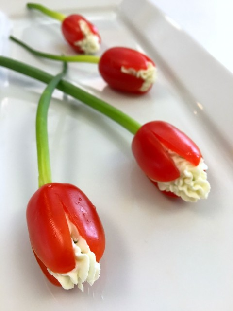 Loose Grape Tomato Cream Cheese Tulips on a long white plate
