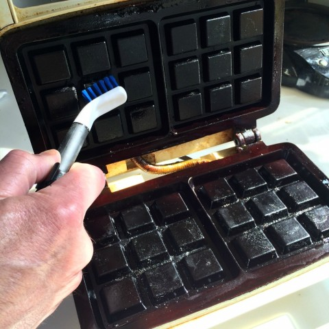 Kitchen Appliance Cleaning Set being used on a waffle iron