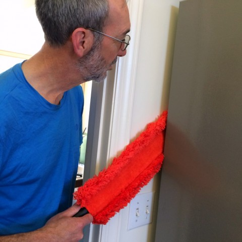 Microfiber Under Appliance Duster being used behind the refrigerator