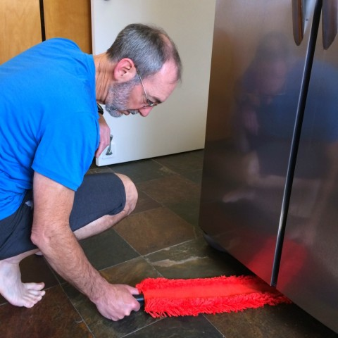 Microfiber Under Appliance Duster being used under the refrigerator