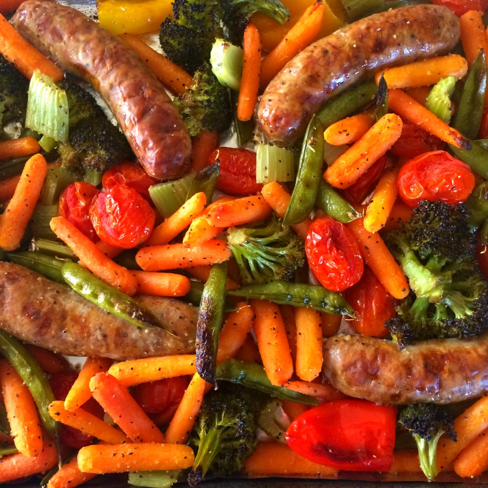Closeup of Easy 4-Ingredient Vegetable Tray Sausage Sheet Pan Dinner with vegetables and 4 sausages on ShockinglyDelicious.com