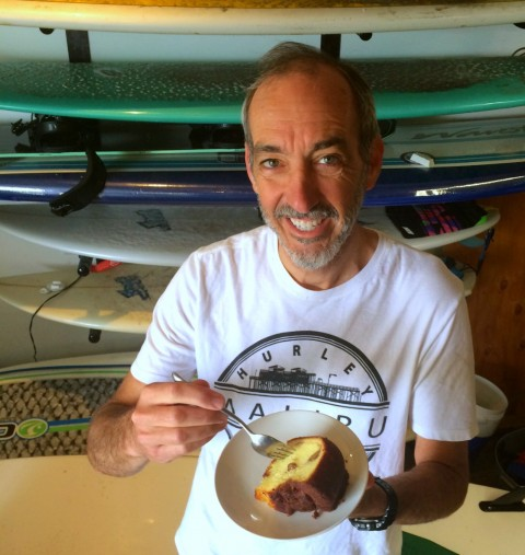 Surfer eating Cinnamon Walnut Coffee Cake from Boston Coffee Cake