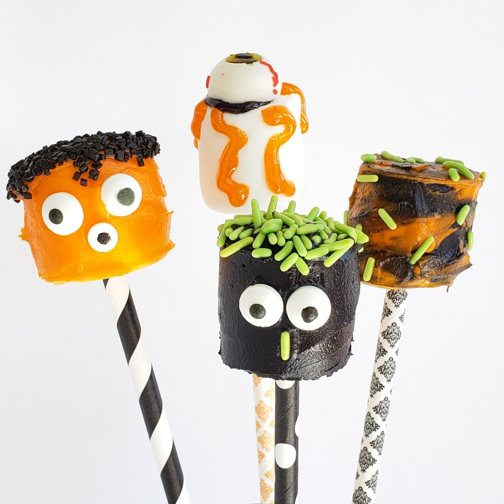 Marshmallows decorated like monster heads delight everyone at Halloween time. Great for a kids' party or neighborhood get-together | ShockinglyDelicious.com