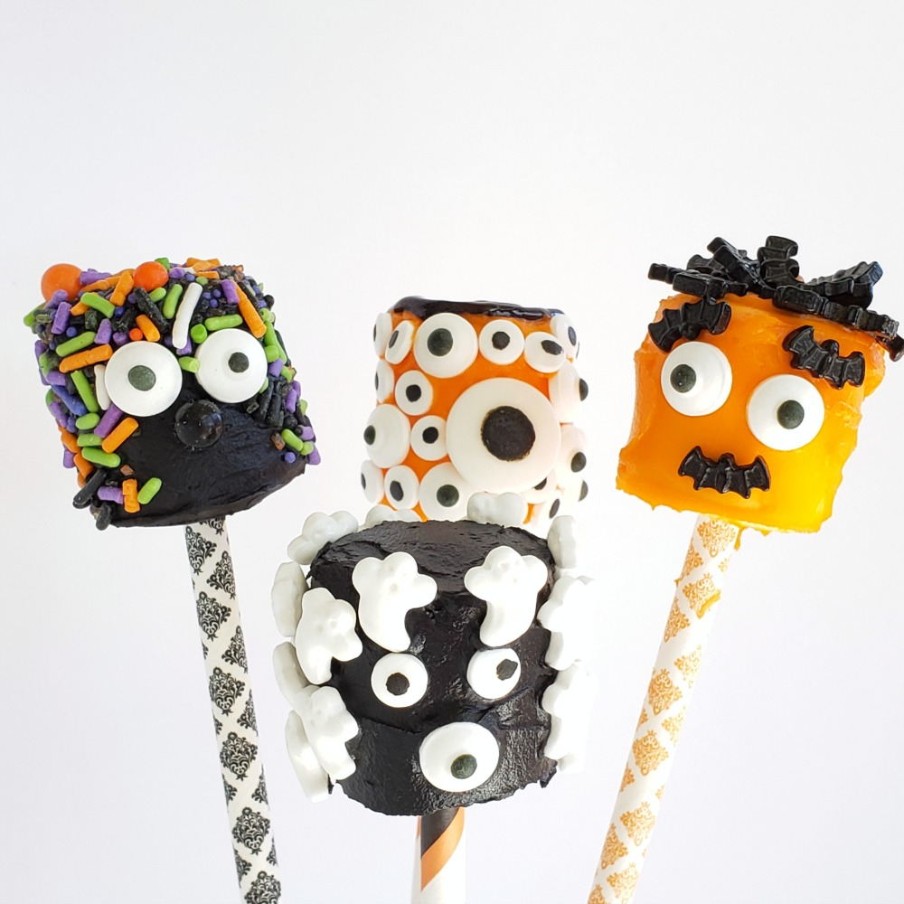 4 more decorated Monster Marshmallows stuck into patterned straws on ShockinglyDelicious.com