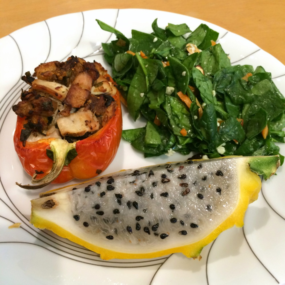 Stuffed Pepper on a dinner plate with Spinach Salad and Passionfruit for dinner