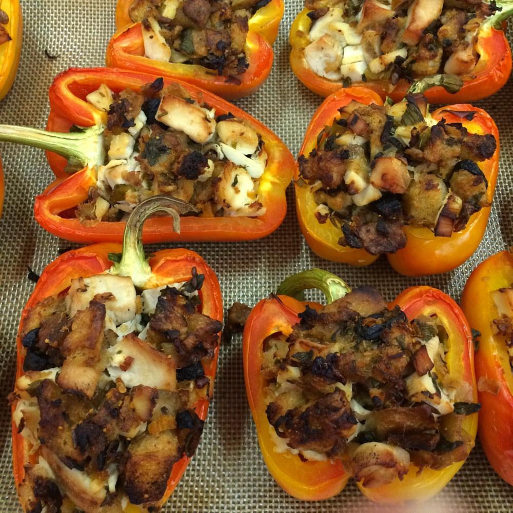 Turkey and Stuffing Stuffed Peppers Baked and out of the oven, on the baking sheet