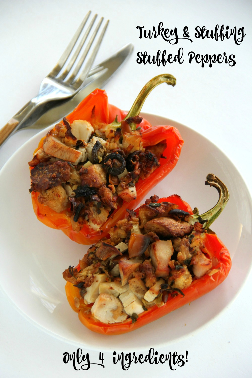 Turkey and Stuffing Stuffed Peppers on a white plate on a white background