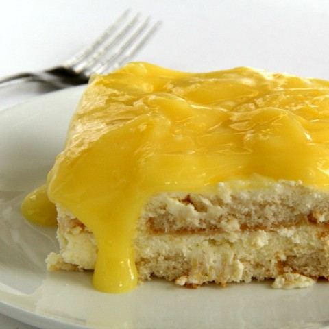 Piece of Lemon Icebox Cake on a white plate on ShockinglyDelicious.com