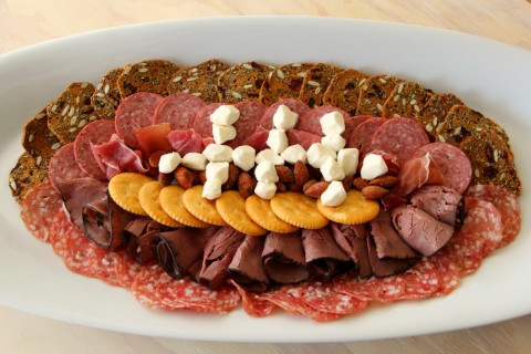 A Football-Shaped Meat and Cheese Plate might be the perfect game-day appetizer. Create it out of your favorite meats, cheeses and crackers. Touchdown!