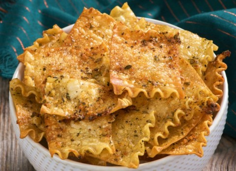 Oven-Baked Herbed Lasagna Chips: Lasagna noodles are transformed into tasty, herby, cheesy chips for snacking in this easy recipe.