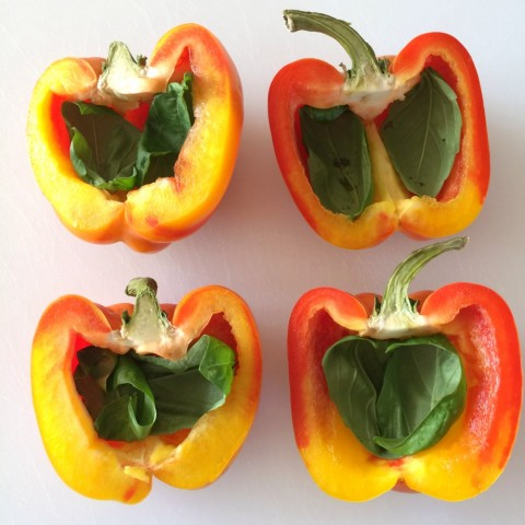 Enjoya Peppers cut in half with basil leaves inside