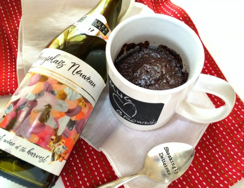 Mug brownie with red Beaujolais Nouveau wine in a white mug