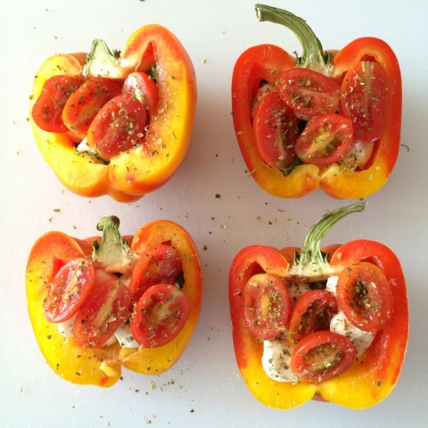 Striped Enjoya peppers cut in half with herb seasoning on top